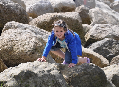 Climbing on the rocks at Lyme Regis